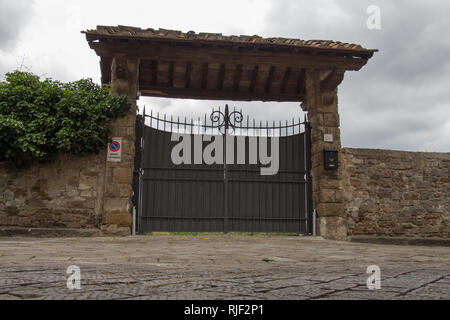 Italy, Florence - May 07 2017: the view of entrance gate to typical Italian villa house on May 05 2017 in Florence, Tuscany, Italy. - Stock Photo