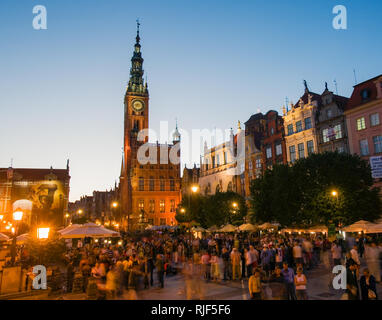 Gdansk, Poland; Dlugi Targ (Long Market) and Old Town Hall at dusk with Neptune statue. - Stock Photo
