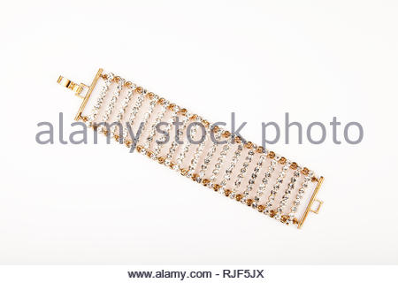 gold female bracelet white background studio - Stock Photo