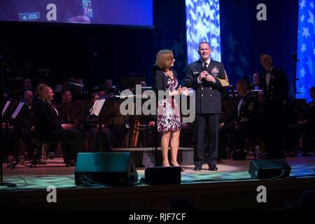 BETHESDA, Md. (Oct. 05, 2017)  Master Chief Petty Officer of the Navy (MCPON) Steven S. Giordano, right, introduces the U.S. Navy Band at he Music Center at Strathmore in Bethesda, Maryland for the celebration of the 242nd birthday of the U.S. Navy. Each October, the U.S. Navy Band celebrates the birth of the United States Navy with an annual concert that highlights the diversity of the Navy, its various missions around the globe and its rich history and heritage and honors veterans and all who serve. - Stock Photo