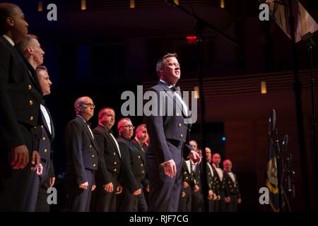BETHESDA, Md. (Oct. 05, 2017) Senior Chief Musician Courtney Williams, from Greenbrier, Tennessee, sings a sea chanty with the U.S. Navy Band at the Music Center at Strathmore in Bethesda, Maryland for the celebration of the 242nd birthday of the U.S. Navy. Each October, the U.S. Navy Band celebrates the birth of the United States Navy with an annual concert that highlights the diversity of the Navy, its various missions around the globe and its rich history and heritage and honors veterans and all who serve. - Stock Photo