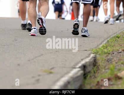 Service members of Joint Task Force Guantanamo and Naval Station Guantanamo Bay run up John Paul Jones Hill during the American Red Cross 5K run/walk, March 21. Event proceeds went to the American Red Cross volunteer support program, with more than 250 people participating in the run. - Stock Photo