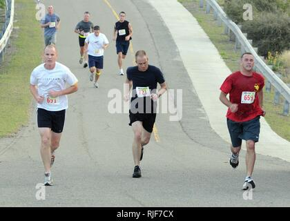 GUANTANAMO BAY, Cuba – Service members of Joint Task Force Guantanamo and Naval Station Guantanamo Bay run up John Paul Jones Hill during the American Red Cross 5K run/walk, March 21, 2010. Event proceeds went to the American Red Cross volunteer support program, with more than 250 people participating in the run.  JTF Guantanamo conducts safe, humane, legal and transparent care and custody of detainees, including those convicted by military commission and those ordered released by a court. The JTF conducts intelligence collection, analysis and dissemination for the protection of detainees and  - Stock Photo