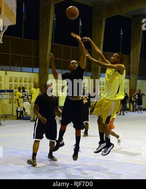A Djiboutian player shoots during a basketball game against an American team, made up of players from Combined Joint Task Force and Camp Lemonnier, at Djibouti University, Djibouti, July 16, 2013. The U.S. and Djibouti women's and men's basketball teams compete weekly at the university. - Stock Photo