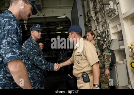 USS NEW ORLEANS (LPD 18),  (July 31, 2010) USS New Orleans (LPD 18) Commanding Officer Cmdr. Jeff Oakey greets Colombian Commander of Surfaces Forces Pacific, Cmdr. Jose Betancur as he comes aboard for briefings while the ship makes a port visit to Bahia Malaga Naval Base, Colombia during Amphibious-Southern Partnership Station 2010..Amphibious Squadron 5, USS New Orleans (LPD 18) and embarked Navy and Marine Corps units are participating in Amphibious-Southern Partnership Station 2010, a combined amphibious exercise designed to enhance cooperative partnerships with maritime forces from Argent - Stock Photo