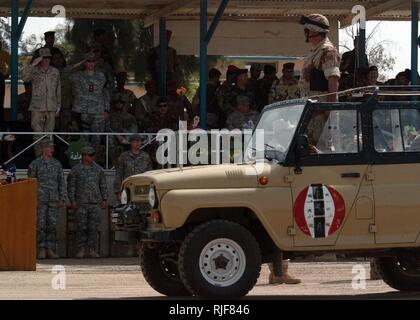 An Iraqi army officer stands at attention in his vehicle while performing a pass and review during a change of command ceremony on Camp Taji, Iraq, May 15, 2006. The Iraqi army 2nd Brigade, 9th Mechanized Division is assuming the command of the Sabeaa Al-Boor and Hora Al-Bash battlespace from U.S. Army Soldiers with 7th Squadron, 10th Cavalry, 1st Brigade, 4th Infantry Division. The Iraqi soldiers will take the lead and conduct their own counterinsurgency operations in this battlespace. - Stock Photo