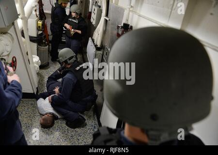 BLACK SEA (Dec. 11, 2015) Sailors aboard USS Ross (DDG 71) conduct a anti-terrorism force protection training while operating in the Black Sea Dec. 11, 2015. Ross, an Arleigh Burke-class guided-missile destroyer, forward deployed to Rota, Spain, is conducting a routine patrol in the U.S. 6th Fleet area of operations in support of U.S. national security interests in Europe. - Stock Photo