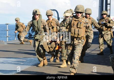 Marines assigned to Fleet Anti-terrorism Security Team Pacific (FASTPAC) conduct medical evacuation training aboard U.S. 7th Fleet flag ship USS Blue Ridge (LCC 19). FASTPAC is a U.S. Marine Corps security augmentation force under the operational control of commander, U.S. 7th Fleet. - Stock Photo