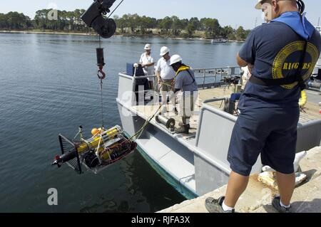 Remote Environmental Monitoring Units (REMUS) with an autonomous docking station from Woods Hole Oceanographic Institution (WHOI) is lowered into the water pierside during the Autonomous Underwater Vehicle (AUV) Fest 2007, hosted by the Naval Surface Warfare Center Panama City and sponsored by the Office of Naval Research. AUV Fest is the largest in-water demonstration of unmanned underwater, surface, air and ground vehicles. - Stock Photo