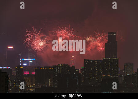 Hong Kong, China. 6th Feb 2019. Fireworks shine over Victoria harbour as seen from Ngau Chi Wan, an area near to Kowloon Peak. Credit: Visions of Asia/Alamy Live News - Stock Photo