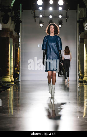 Barcelona, Spain. 6th Feb, 2019. A model walks the runway at the Esau Yori fashion show presenting the new collection during 080 Barcelona Fashion Week Credit: Matthias Oesterle/Alamy Live News - Stock Photo
