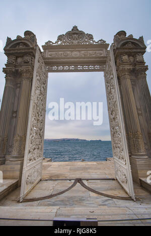 View from one of  the iron gates with ottoman columns of the Dolmabahce Palace. The door overlooking the Bosphorus and the sea in Istanbul, Turkey - Stock Photo