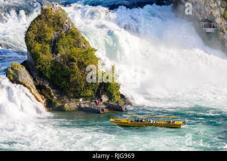 Tourist boat at the Rhine Falls with view rocks, near Schaffhausen, Canton Schaffhausen, Switzerland - Stock Photo