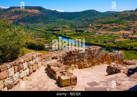 Bosa, Sardinia / Italy - 2018/08/13: Panoramic view of the town of Bosa by the Temo river and surrounding hills seen from Malaspina Castle hill - know - Stock Photo