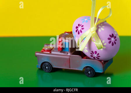 Pickup toy carrying one decorated easter egg - Stock Photo