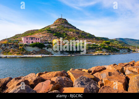 Bosa Marina, Sardinia / Italy - 2018/08/13: Panoramic view of the hill with television broadcasting towers and antennas over the town of Bosa Marina b - Stock Photo