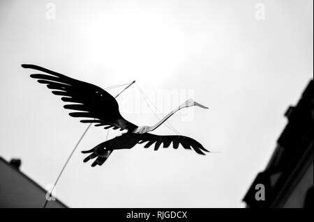 Stork silhouette decorations during Christmas on French street black and white photo - Stock Photo