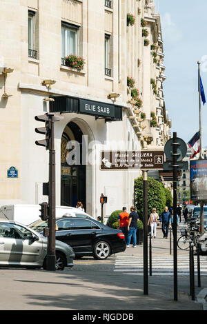 PARIS, FRANCE - MAY 21, 2016: Pedestrians in front of Ellie Saab haute couture luxury fashion store facade in central Paris - Stock Photo