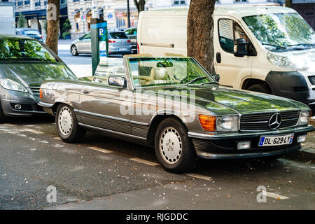 PARIS, FRANCE - MAY 21, 2016: Vintage Mercedes-Benz SL convertible car parked on Paris street with opened roof-top - Stock Photo