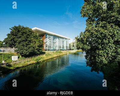 STRASBOURG, FRANCE - SEP 19 2017: Aerial still drone view of Canal de Marne au Rhin with Council of Europe Agora building in the background in summer evening with pedestrian walking near the canal - Stock Photo