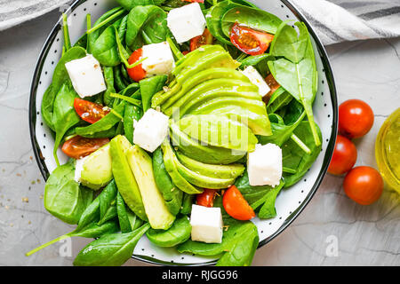 Top view of healthy vegetables and cheese salad, mediterran diet healthy eating concept, closeup of organic healthy vegetables with avocado, feta chee - Stock Photo
