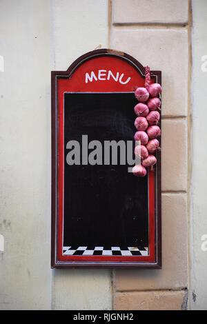 empty, blank, unlabeled menu board at a restaurant at the Campo de fiori, Rome, Italy - Stock Photo