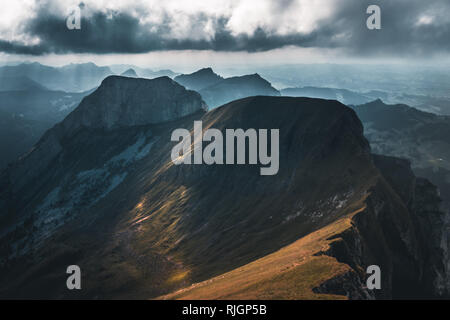 Sinister cloudy panorama over the Tomlishorn peak as seen from the top of Mount Pilatus, Lucerne, Switzerland - Stock Photo