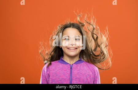 Little cutie. childhood happiness. Family. childrens day. Portrait of happy little child. Kid fashion and sportswear. Happy little girl with long hair. Small girl child. Hairdresser for kids. - Stock Photo