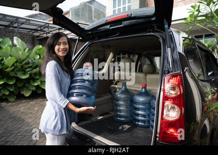 buying a new gallon of water - Stock Photo