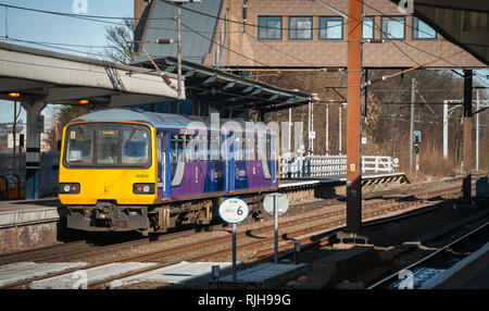 Class 144 Pacer diesel multiple unit train in Northern livery waiting at a station, on it's way to Leeds, UK. - Stock Photo