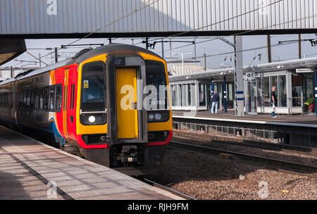 Class 158 express sprinter passenger train in East Midlands Trains livery waiting at a railway station platform in the UK. - Stock Photo