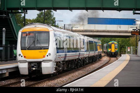 Class 172 Turbostar passenger train in London Midland livery with a class 168 Clubman in Chiltern Railways livery waiting at a station platform in the - Stock Photo