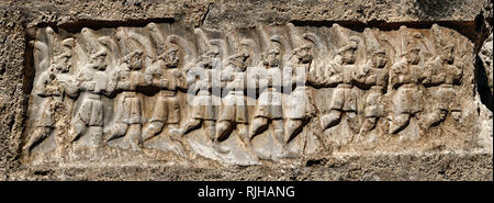 Sculpture of the twelve gods of the underworld from the 13th century BC Hittite religious rock carvings of Yazılıkaya Hittite rock sanctuary, chamber  - Stock Photo