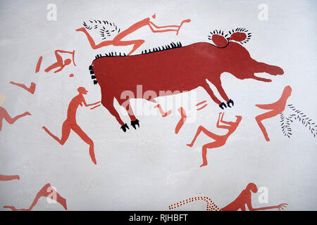 Close up of a recontructed fresco of an original found at Catalhoyuk. The men are hunting an animal. Reconstructed houses, Painted by Mutlu Gundiler.  - Stock Photo