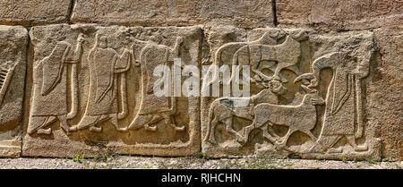 Pictures & Images Hittite relief sculpted orthostat panels of the Sphinx Gate. Left panel depicts a procession following (right) a man leading goats t - Stock Photo