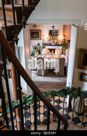 View from staircase through open doors to dining room at Christmas - Stock Photo