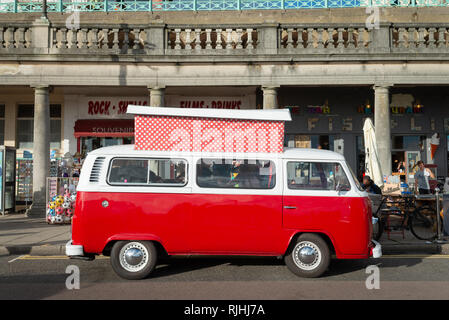 A red and white Volkswagen VW campervan parked on Madeira Drive in Brighton, Sussex, England. - Stock Photo