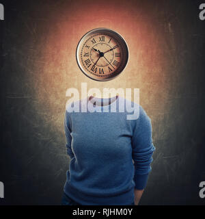 Surreal image anonymous woman with mystic clock instead her head over dark blackboard background. Emotional concept of time in educational process. Bu - Stock Photo