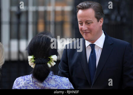 Aung San Suu Kyi meets with Britain's Prime Minister David Cameron on October 23, 2013, at 10 Downing Street in London. Stock Photo