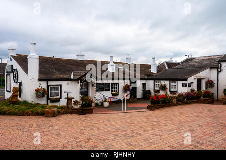 The whitewashed buildings of the traditional blacksmith's shop built in 1713, used as a marriage venue for eloping couples wishing to marry - Stock Photo