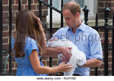 Prince William & Catherine Duchess of Cambridge hold their new born baby at the Lindo Wing at St Mary's Hospital in London. July 23, 2013. - Stock Photo