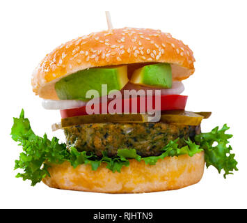Delicious homemade vegan burger with fresh vegetables. Isolated over white background - Stock Photo
