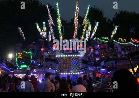 Fun fair in Gloucester Park, Gloucester, England, UK. The event is held annually in the city. August 2018 - Stock Photo