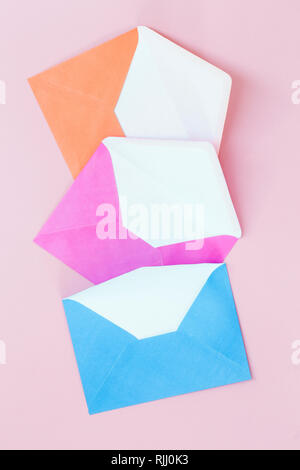 Colorful envelopes on pink  background - Stock Photo