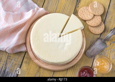 Traditional cheesecake on the wooden table flat lay - Stock Photo