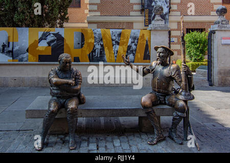 Alcala de Henares, Spain; August , 2018: Sculpture of Don Quijote with Sancho Panza in front of the birthplace of Miguel de Cervantes in Alcala de Her - Stock Photo