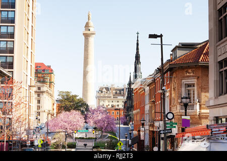 Cityscape of Baltimore with United Methodist Church steeple and Washington monument in spring, Maryland, USA - Stock Photo