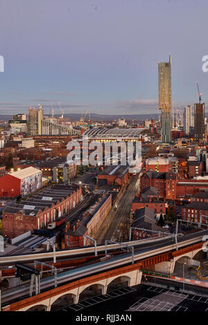 Manchester city centre skyline view across the rooftops from Salford  Beetham Tower, Liverpool Road, and MOSI Museum of Science and Industry site - Stock Photo