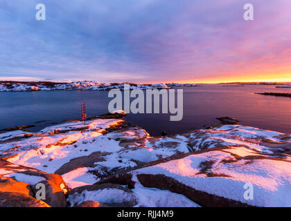 Pink sunset over rocky island at west coast of gothenburg,Sweden - Stock Photo