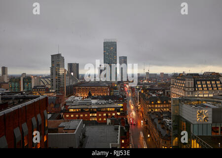 View from 125 Deansgate looking towards Beetham Tower and traffic on Deansgate - Stock Photo